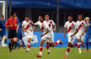 NANJING, CHINA - AUGUST 18:  Gerald Tavara #7 of Peru celebrates in style after scoring against Iceland during the 2014 FIFA Boys Summer Youth Olympic Football Tournament Preliminary Round Group C match betwenn Iceland and Peru at Jiangning Sports Centre Stadium on August 18, 2014 in Nanjing, China.  (Photo by Stanley Chou - FIFA/FIFA via Getty Images)
